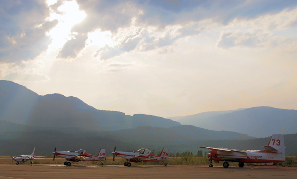 BC Forest Service Air tankers at Revelstoke Airport await their next dispatch. Simon Hunt photo courtesy of Parks Canada