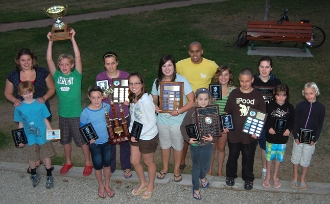 Coaches Megan Pilla and Hardave Birk pose with the kids who received awards at the Aquaducks' annual general meeting on Tuesday. The meeting was held, as it traditionally is, at Queen Elizabeth Park. David F. Rooney photo