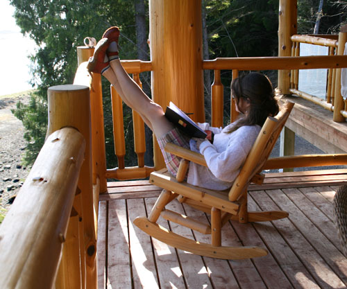 Gwen Lips stretches her legs as she sketches on the lodge deck. Photo courtesy of Cherie Vanoverbeke