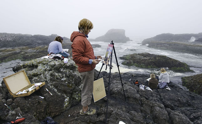 Artists (from left to right) Gwen Lips, Nicola McGarry, Tina Lindegaard and Cherie Vanoverbeke paint on the rocks at South Beach. Photo courtesy of Cherie Vanoverbeke