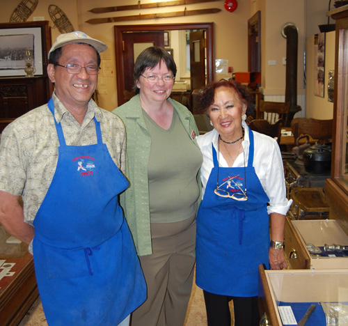 Ronnie and Mary Kwong pose with Revelstoke Museum & Archives Curator Cathy English as she shows off some of the Manning's Chocolates artifacts after last Friday's Beer & Wings Night. David F. Rooney photo
