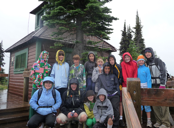 Adrenaline Week at the Community Connections' Pre-Teen Summer Camp brought kids and counsellors to the top of Mount Revelstoke where, among other things, they posed in the rain. Photo courtesy of Anne Corrie