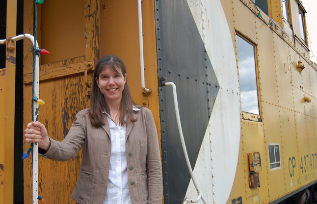 Jennifer Dunkerson, the new executive director of the Revelstoke Railway Museum, poses on the steps of a caboose on the museum grounds. Dunkerson joined the museum just in time for Railway Days. David F. Rooney photo