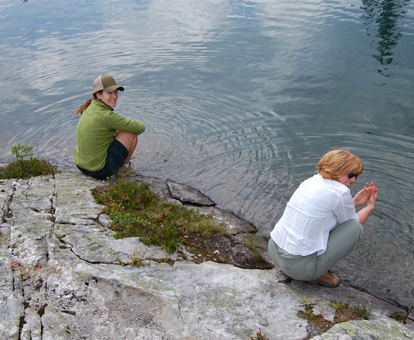 Karen McColl (left) and Jennifer Wolney refresh themselves in the cool, clear waters of Miller Lake. David F. Rooney photo