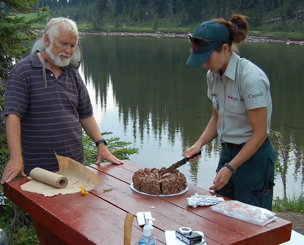 The end of the trail brought a reward to all of the faithful pilgrims: a chocolate cake from the Modern, which Andy Parkin eyes hungrily as Alice Weber slices it. David F. Rooney photo