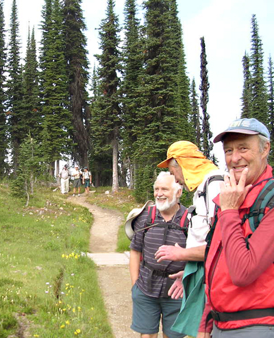 Andy Parkin (left) and Bill Shuttleworth exchange witticisms as Jeff Nicholson seems to ponder the meaning of life along the trail to Eva Lake. Photo courtesy of Hans Travnicek