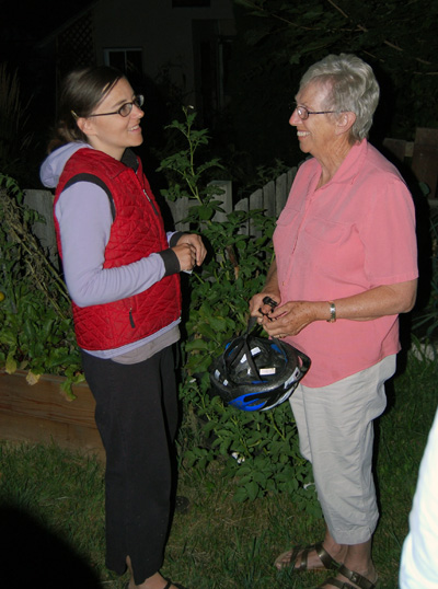 Patience Gribble (left) talks about growing vegetables with Marilyn Parkin during the Garden Guru tour. David F. Rooney photo
