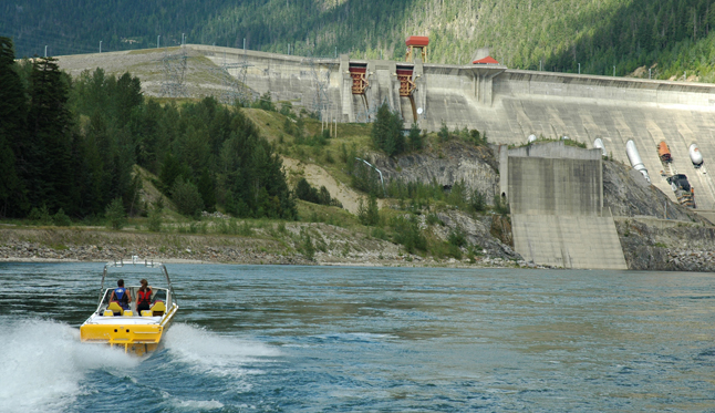 David Adshead pilots his jet boat up the Columbia River towards the massive Revelstoke Dam. Adshead wants to offer jet-boat tours along the river from the dam to Begbie Falls. John Morrison photo courtesy of David Adshead