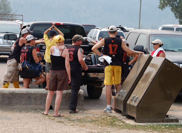 Members of the Fawk-Owie team from Calgary shoot the breeze before heading out of town on Monday. David F. Rooney photo