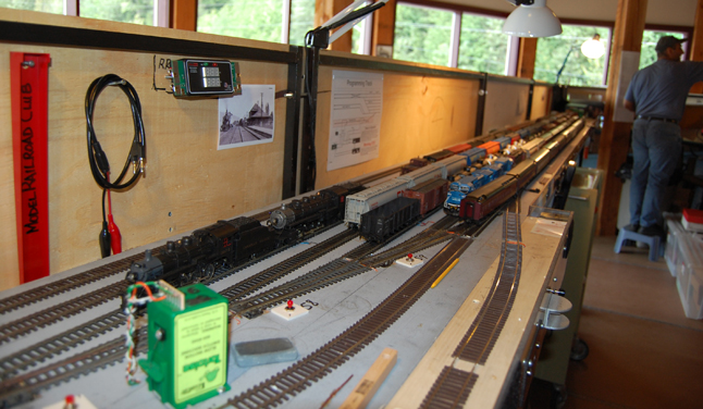 Ever wonder what's behind the facade of the dioramas that model railroaders build? Here's a peek behind the scenes of the diorama that model railroaders have built at the Railway Museum — more trains! In fact, it's a veritable rail yard. David F. Rooney photo