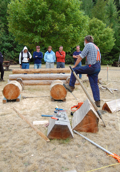 Brian Sumner talks with visitors to the BC Interior Forestry Museum about log-cabin building. David F. Rooney photo