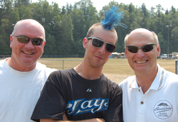 Hair today gone tomorrow. Kevin Clee of Edson, Alta., enjoys his blue hair but gets a foretaste of things to come when he poses with mark McKee (left) and Revelstoke Glacier Challenge Chairman Alan Chell on Saturday. David F. Rooney photo