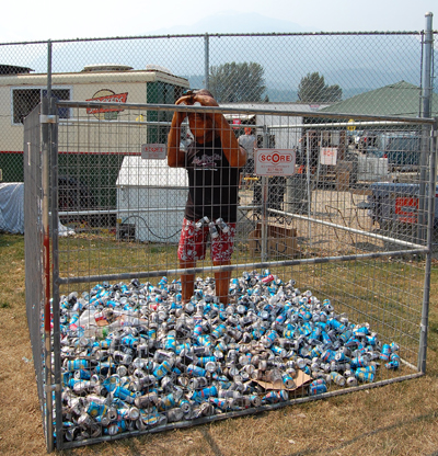 The traditional Sasquatch keeps tabs on a growing mound of empties at Centennial Park. David F. Rooney photo