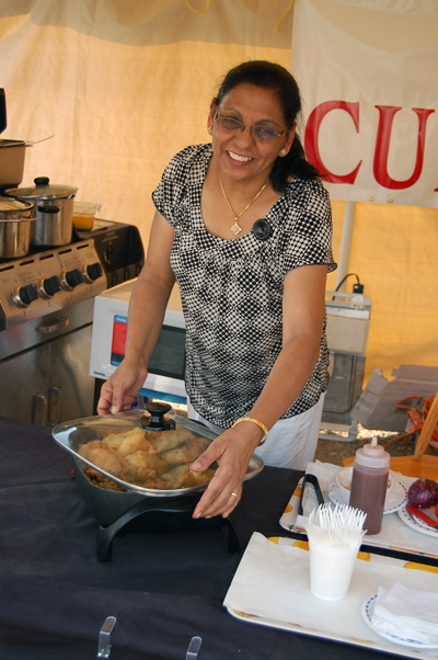 Pam Sanghera whips up some tasty samosas for the dinner-hour crowd on Saturday. David F. Rooney photo