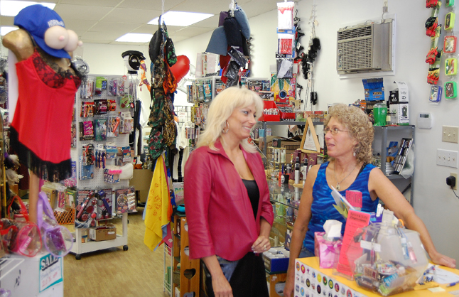 """The Spice O' Life shop, which bills itself as the """"Most tasteful 'Sex Shop' in the West"""" has moved from Second Street East to a new location at 106 Orton Avenue, opposite the Traverse Lounge. Here, Shelly Isfeld (left) talks with proprietor Dinah Collette about the move. David F. Rooney photo"""