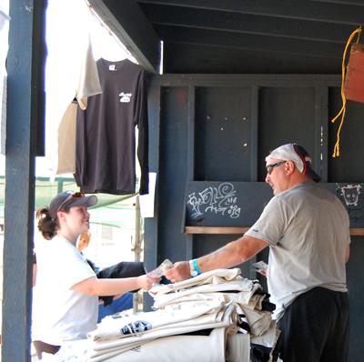 Craig McKee consumates a sale at his T-shirt booth at Centennial Park. David F. Rooney photo