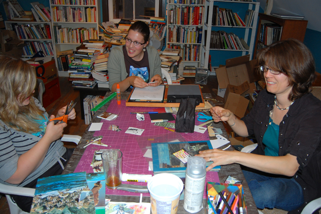 Cherie Vanoverbeke (left), Ariel Christman and Gwen Lips were three of the artists who turned out to make arrtists' trading cards at Castle Joe Books on Tuesday. The cards had to be original and were not for sale. They could only be traded or given away. David F. Rooney photo