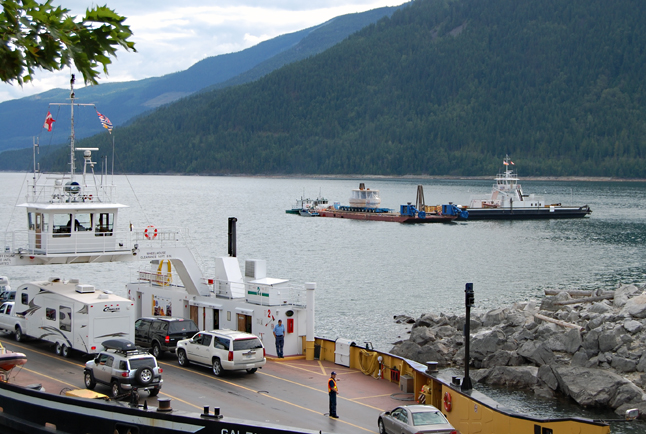 The barge bearing BC Hydro's new Unit 5 turbine rests at anchor beside the MV Shelter Bay as the Galena Bay (foreground) takes on vehicles. David F. Rooney photo