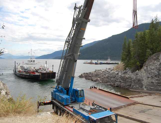 The MV Galena Bay leaves the Shelter Bay ferry landing and sails past the barge carrying BC Hydro's mammoth Unit 5 turbine. David F. Rooney photo