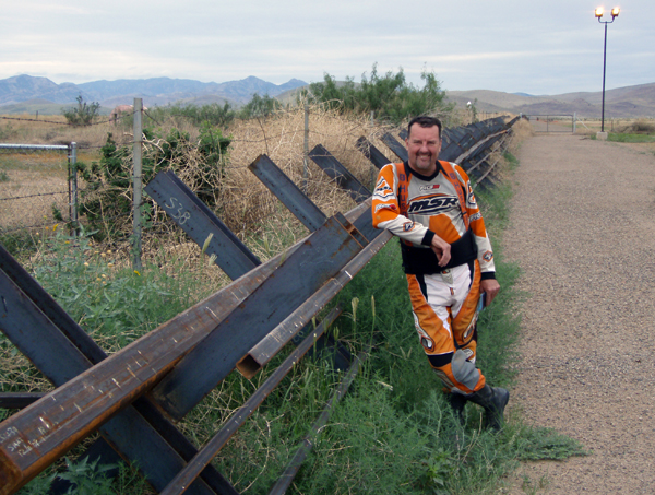 Gary DeBlock rests against a steel fence line. Photo courtesy of Rich Hamiton