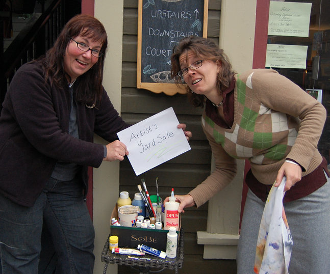 Jen Rogers (left) and Gwen Lips at Castle Joe Books want all local artists to remember the Artists' Yard Sale they have organized as part of the New Moon on Mackenzie festival on Sept. 19. Artists who have unused canvas, paints, pastels, pencils, brushes, easels and other items should drop them off at Castle Joe Books by Wednesday, Sept. 16. David F. Rooney photo