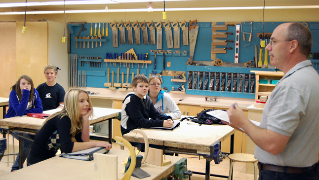 """""""Welcome to high school,"""" intones RSS Shop Taacher Mike Howard to a new crop of Grade Eights. """"We don't eat paste and crayons in here."""" David F. Rooney photo"""