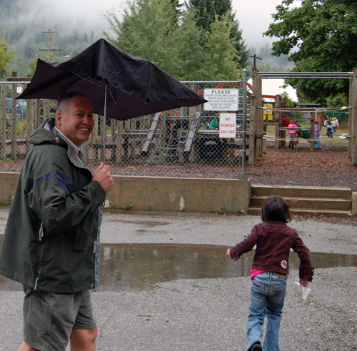 Does this guy need a raise or what? Mount Begbie Teacher Ian Stitchbury drew smiles and a few laughs with his broken umbrella. David F. Rooney photo