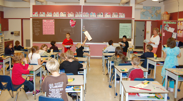 Mount Begbie's Jill Leslie had everything under control in her Grade Three class. Heck they were even raising their hands politely when they wanted attention. David F. Rooney photo