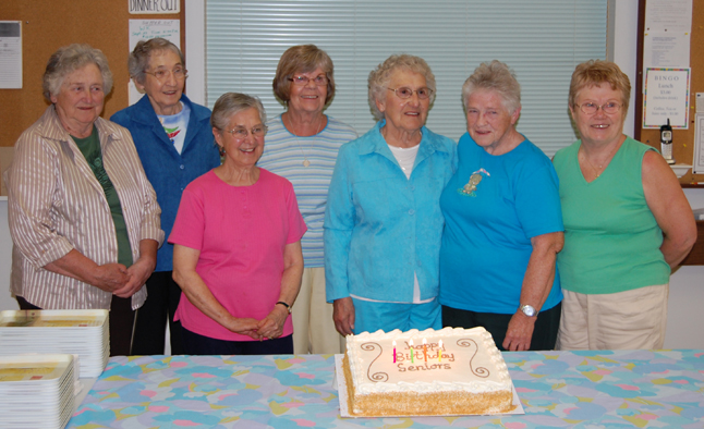 Local seniors celebrated a raft of birthdays from August and September at the Seniors' Centre on Wednesday. Among those who celebrated were (from left to right) Eileen Upper, Ann Brown, Doreen Hewko, Anita Cameron, Elma Harrison, Edith Rudyk and Donna Kaiser. They and a cuple of dozen other seniors celebrated with a sing-along and, of course, pieces of that tasty-looking cake. David F. Rooney photo