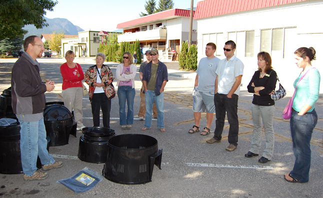 Darcy Mooney, the Columbia Shuswap Regional District's Recycling Manager, talks to ardent composters about the ins and outs of turning yard waste into compost during a demonstration in front of Home Hardware on Friday. David F. Rooney photo