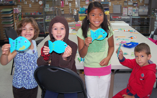 These happy and creative kids — from left to right: Isabel Federico, Ayla Roche, Abigail Brackenbury and Morgan Walker — had a great time learning how to make cards that looked like googly-eyed fish at Got Scraps! on First Street West on Saturday. Well, they might have needed just a little bit of help from mom Patsy Walker and Kate McKenzie and Holly Eastabrook of Got Scraps! Great work kids! David F. Rooney photo