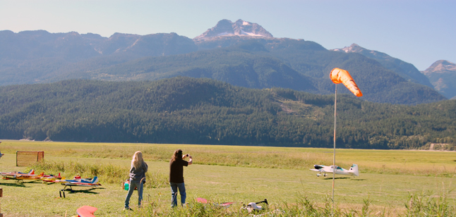 A photographer captures an image of one of the radio-controlled aircraft at Sunday's Fall Fun Fly. David F. Rooney photo