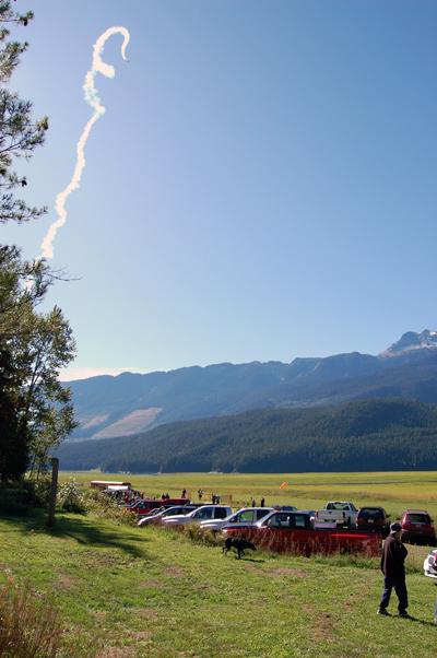 A radio-conrolled aircraft trails smoke as it performs aerobatics at Sunday's Fall Fun Fly. David F. Rooney photo