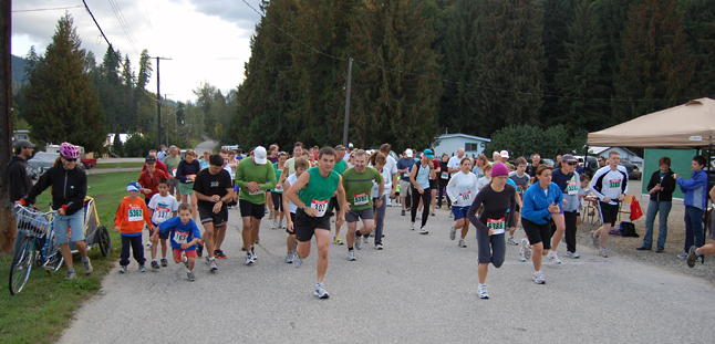 Runners leap into action at the start of Saturday's Revelstoke Community 5K, 10K and Half Marathon. Scores of avid runners came out for the event, which started at the Alliance Church parking lot on Illecillewaet Road. David F. Rooney photo