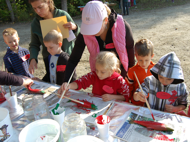 Let's paint red fish! Children painted fish red and green then gently pressed paper onto their bodies to create paintings. David F. Rooney photo