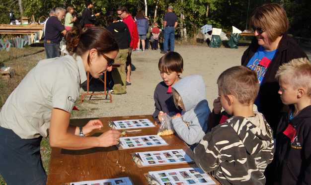 Parks Canada's Alice Weber tells kids the rules of the Kokanee Fish Festival Scavenger Hunt down at Bridge Creek on Friday. David F. Rooney photo