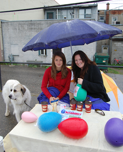 Laura Richardson (left) and Jennifer Ryan — and of, course, their pal Fleetwood Mac (far left in the fur coat) were introducing potential customers to a new doggie toy, the Play Pal Scrambler.David F. Rooney photo