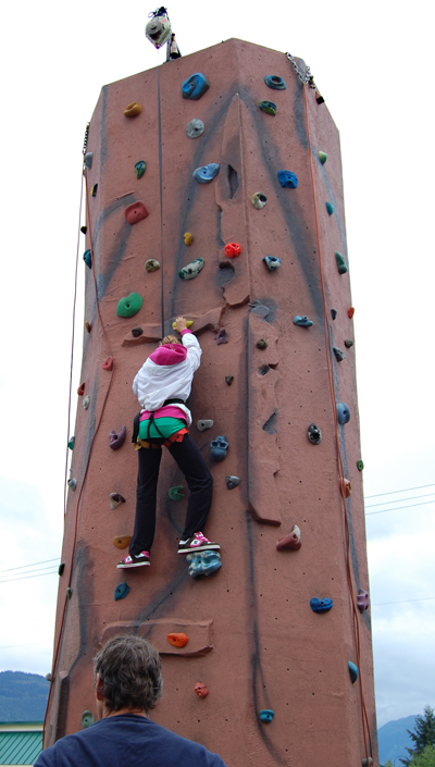 Kelsey March ascends the climbing wall set up by the Credit Union. David F. Rooney photo