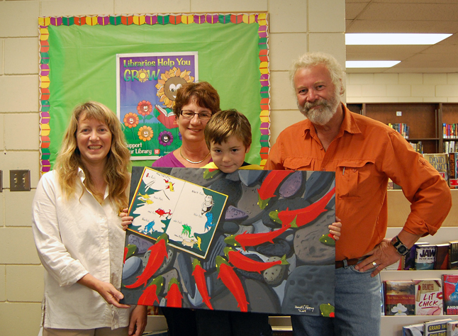 Young Austin Thomas (center) was the winner of One Fish, Two Fish, Red Fish, Blue Fish, which was the draw prize for this year's Summer Reading Club program. Master Thomas poses with Assistant Librarian Lucie Bergeron, Head Librarian Joan Holzer and painter David Rooney. About 300 children were in contention for the painting. Lucie and Joan will formally present Austin with the painting during an assembly at Columbia Park Elementary School next week. Photo courtesy of Caroline Thomas