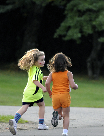 Young Madeline Carter and Devon Gale run down the street during the Community Run. Photo ocurtesy of Karyn Molder