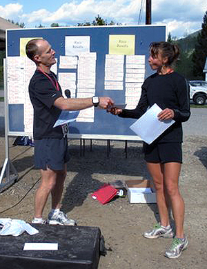 Anne Marie Gill was the top female runner in the Community Run's Half Marathon Saturday with a time of 1:39:23. Here, she receives a prize from Community Run organizer John Yakielashek. Photo courtesy of Sarah Newton