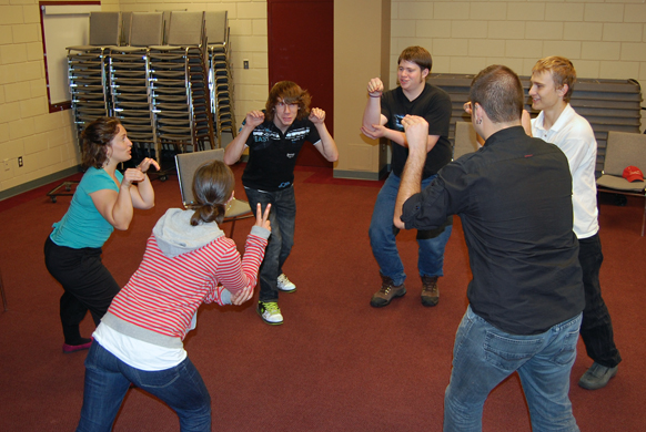 Members of the brand new Theatre Sports Club run through an exercise at the Community centre under the supervision of drama teacher Anita Hallewas Monday evening. David F. Rooney photo