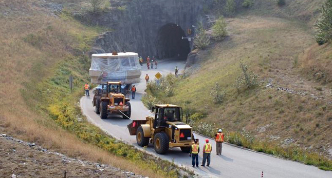 Finally unloaded from the transporter, the turbine is carefully carried through the 100-metre-long tunnel that leads to the Revelstoke Dam. Dusty Veideman photo courtesy of BC Hydro