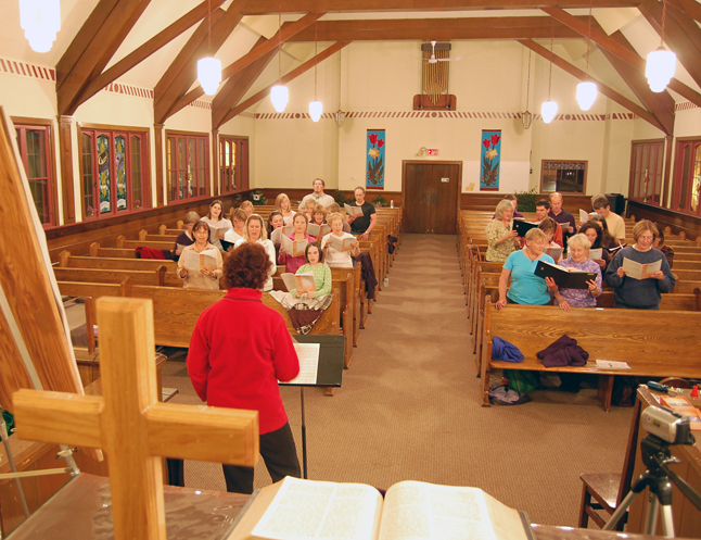 Robyn Abear (left in the red fleece) runs members of the Community Choir through their paces during a rehearsal Tuesday evening of their portion of the programme for the Voices for Hospice Concert that will be held at the United Church on Oct. 17 at 7 pm. Accompanied by pianist Lida Carey, the choir sang beautifully. How beautifully, you may ask? You can judge for yourself by going to The Current Video on the front of The Revelstoke Current news site. Be sure to pencil in that concert on your calendar and come out to show your support for our community's Hospice Society. David F. Rooney photo