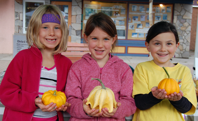 These three young girls — Cassidy Legebokow, Hannah Vickers and Emily MacLeod — had a lovely time picking out their favourite decorative squash and pumpkins from the stall of Ian Richardson of Rocky Ridge Farm near Mara on Saturday. There are only a few outdoor Farmers' Markets left this year, although there will be indoor ones later this autumn and winter. David F. Rooney photo