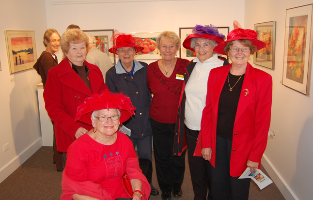 Pat Anderson poses with some of her friends, the Red Hat Ladies. The popular watercolourist enjoyed her own opening on Friday night: Seeing Red. Like From the Mountains two the Sea, her show runs until Nov. 6. David F. Rooney photo