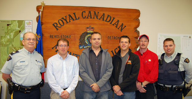 "long-service Revelstoke Auxiliary Constables Paul Carter (second from the left), Joe Marcoffio and Eric Scarcella and retired Auxiliary Troy Tompkins (second from the right) received some awards on Tuesday from RCP Sgt. Art Kleinsmith and Const. Garry McLaughlin who works closely with the volunteers. Carter, Marcoffio and Scarcella received Certificates of Appreciation five-year service pins for having served more than five years with the Force. Tompkins has retired and received a retirement badge. Kleinsmith congratulated them on behalf od detachment commander Staff-Sgt. Jackie Olson. McLaughlin noted that the regular force members they work with deeply appreciate  them. ""There is nobody in this detachment who doesn't value what you do for us,"" he said. The same could probably said by most people in town. Congratulations. David F. Rooney photo"