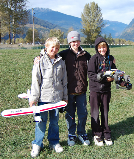 Jackson, Isaac and Wyatt Callaghan pose with the controlled aircraft and roadster they had fun with at Centennial Park on saturday. David F. Rooney photo