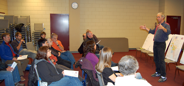 City Planner John Gunther (right) talks to a group of 13 central residential area residents Wednesday about the need to form neighbourhood community groups that can help guide the development process. David F. Rooney photo