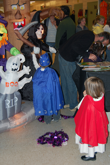 The Grim Reaper by the entrance to Monday evening's Halloween Party at the Community Centre appeared to be irresistible to kids. This little wizard was the third child in about four minutes who went and tried to yank the scythe out of his hands. David F. Rooney photo